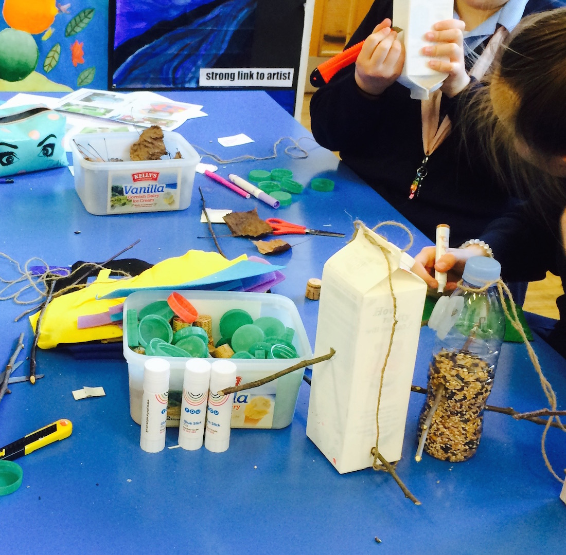making bird feeders with recycled cartons